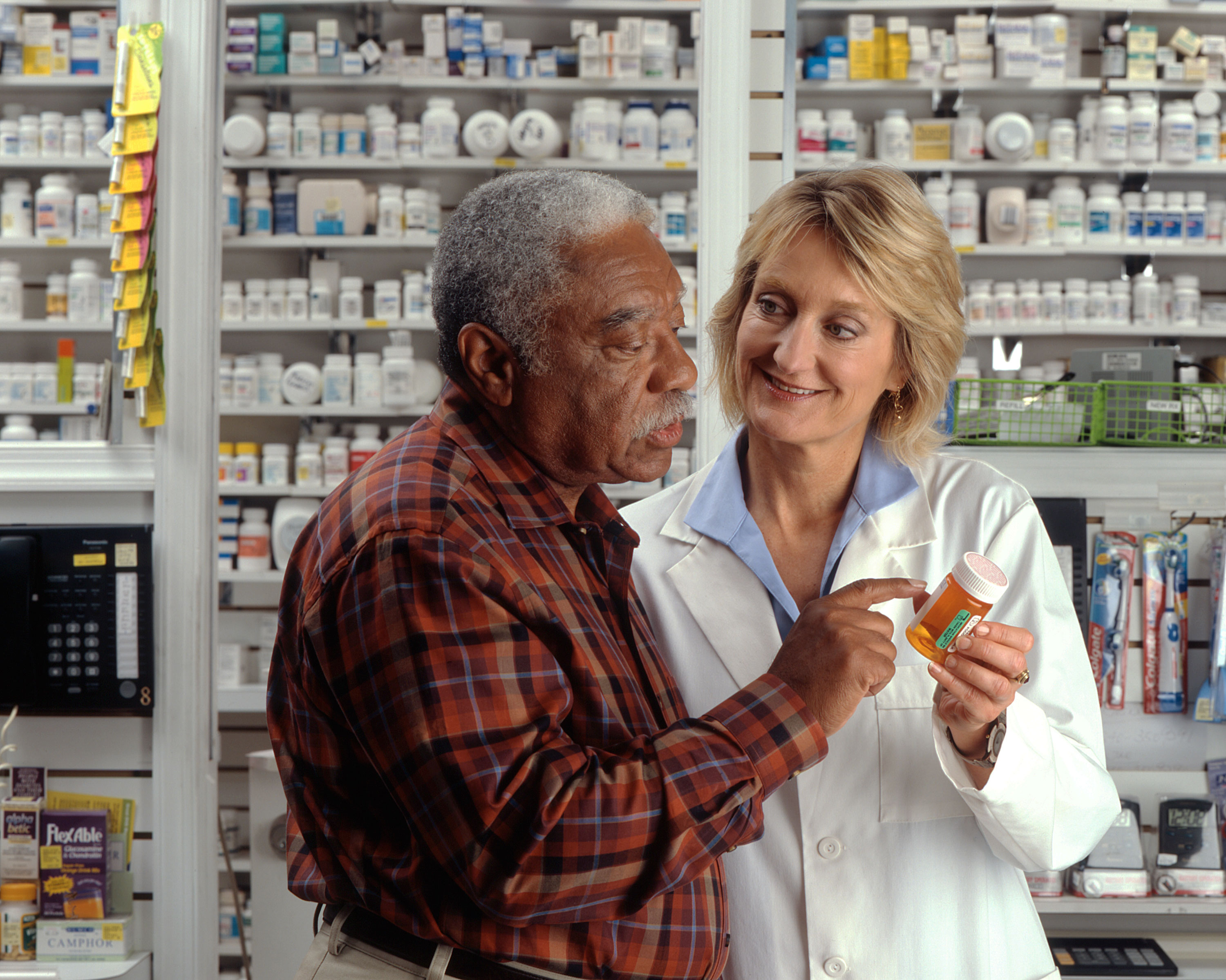 pharmacist helps man